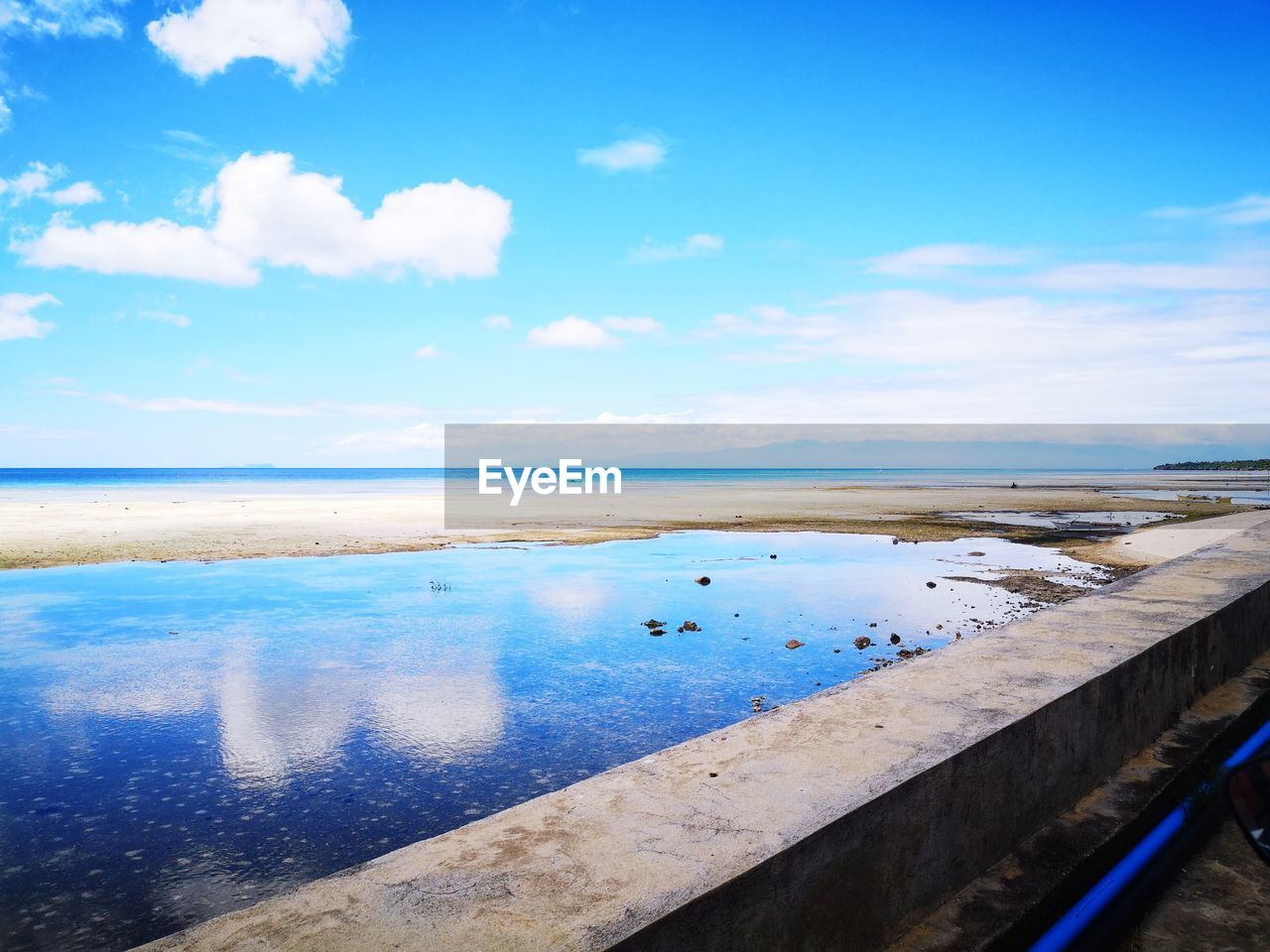 water, cloud - sky, sky, scenics - nature, beauty in nature, blue, tranquil scene, sea, tranquility, day, nature, horizon, horizon over water, no people, reflection, outdoors, non-urban scene, idyllic, land