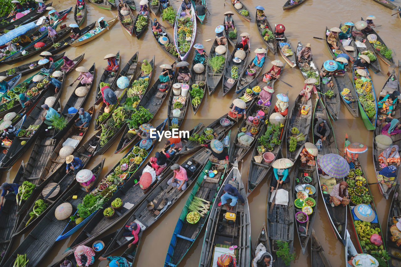 High angle view of floating market in canal