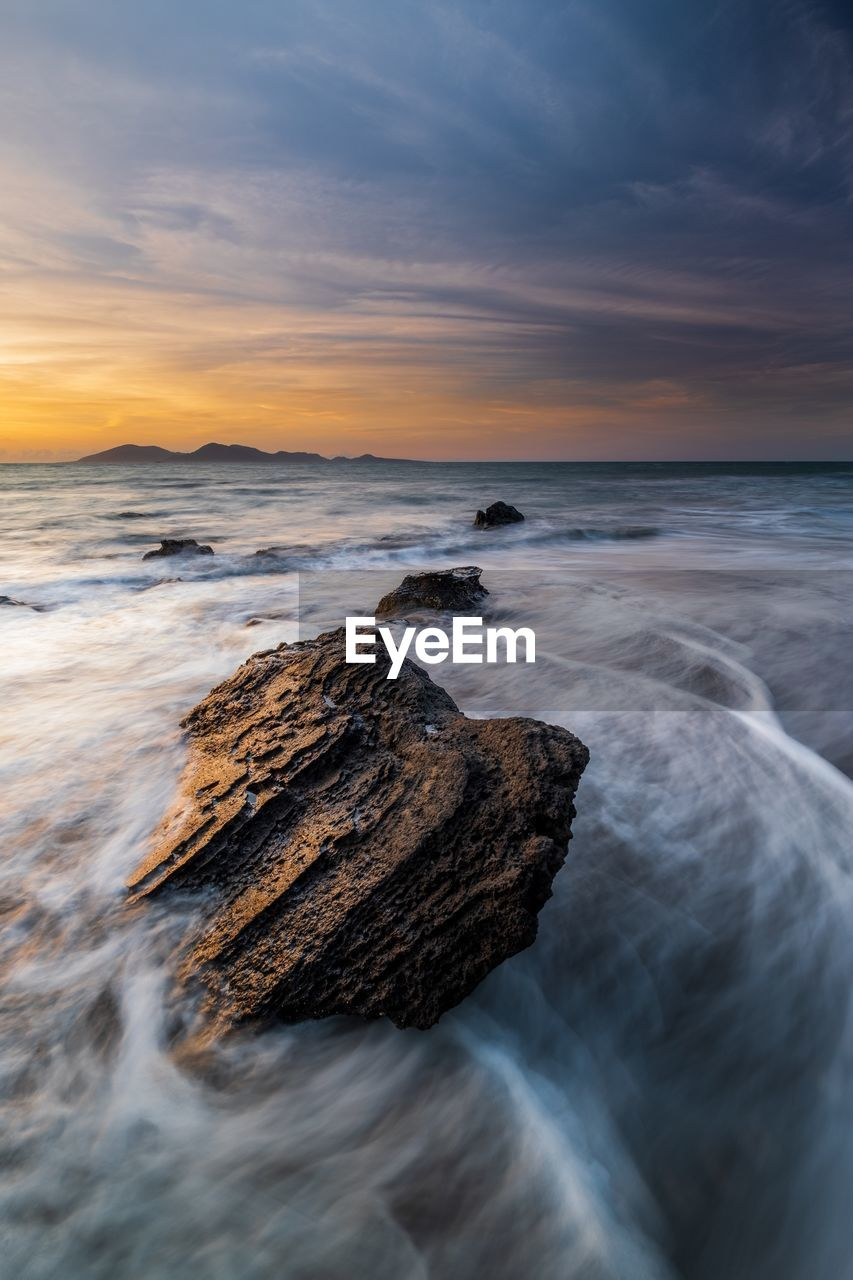 sea, water, sky, beauty in nature, scenics - nature, horizon over water, horizon, motion, sunset, rock, cloud - sky, beach, solid, land, rock - object, long exposure, wave, idyllic, nature, no people, outdoors, flowing water, rocky coastline