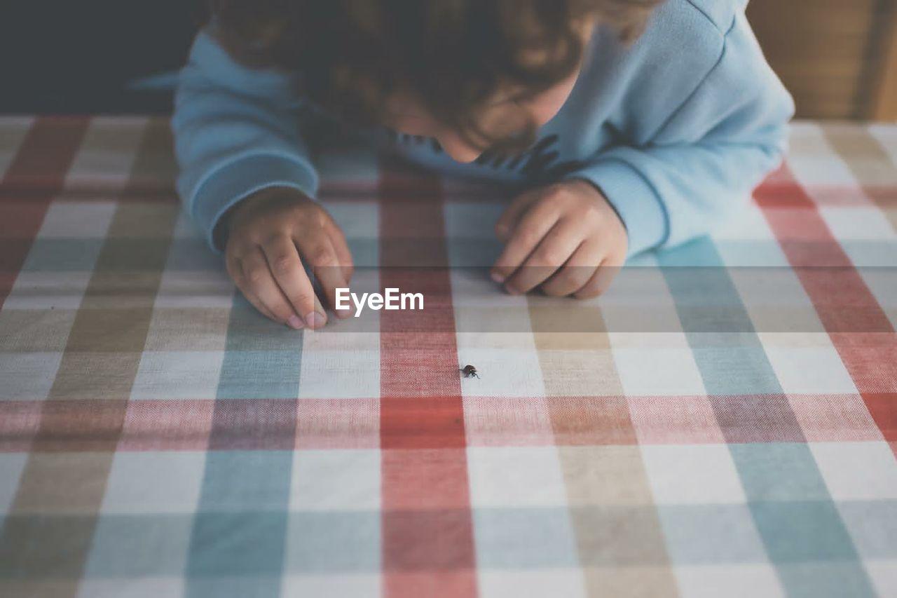 High angle view of boy on table