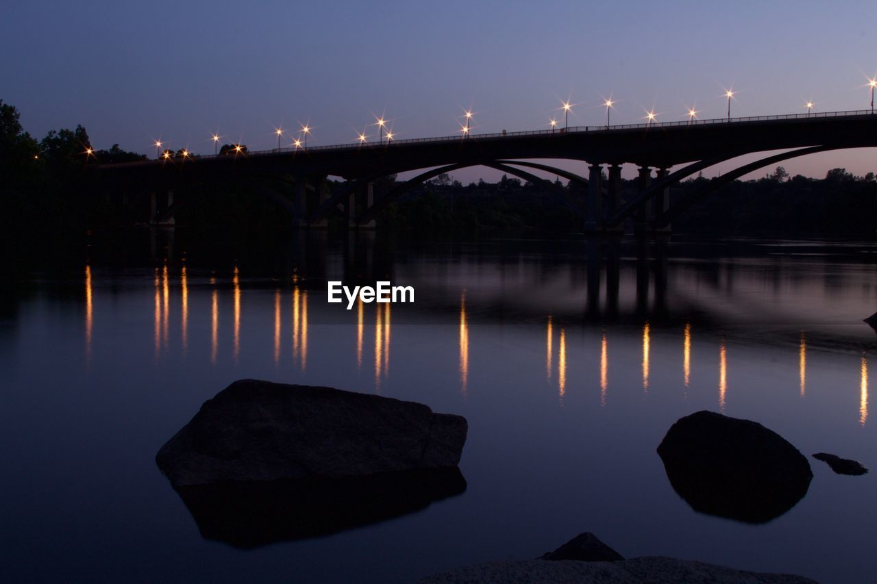 water, sky, reflection, architecture, nature, no people, built structure, connection, bridge, night, illuminated, river, bridge - man made structure, rock, scenics - nature, outdoors, solid, transportation