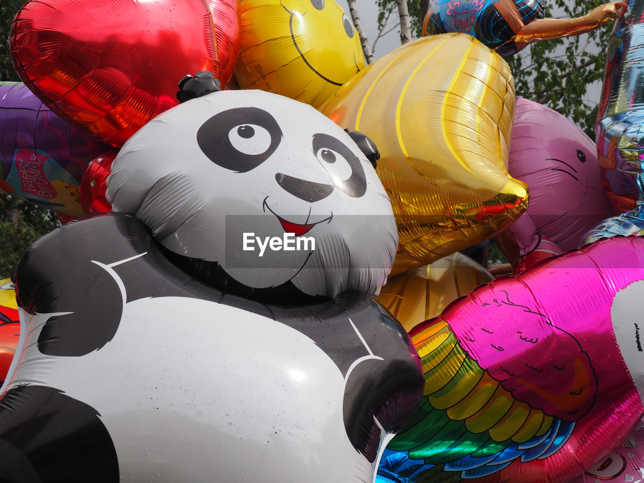 Low angle view of multi colored balloons during carnival