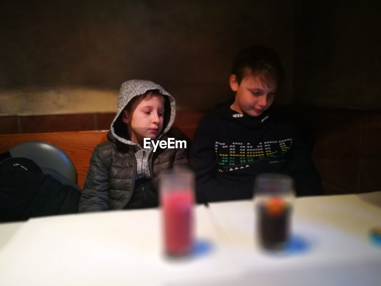 Boy Sitting At Table In Restaurant
