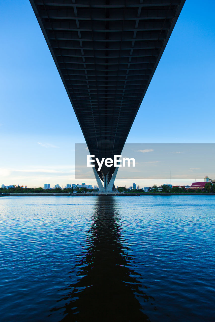 bridge - man made structure, connection, architecture, river, built structure, water, waterfront, transportation, outdoors, bridge, blue, no people, sky, underneath, day, city, nature