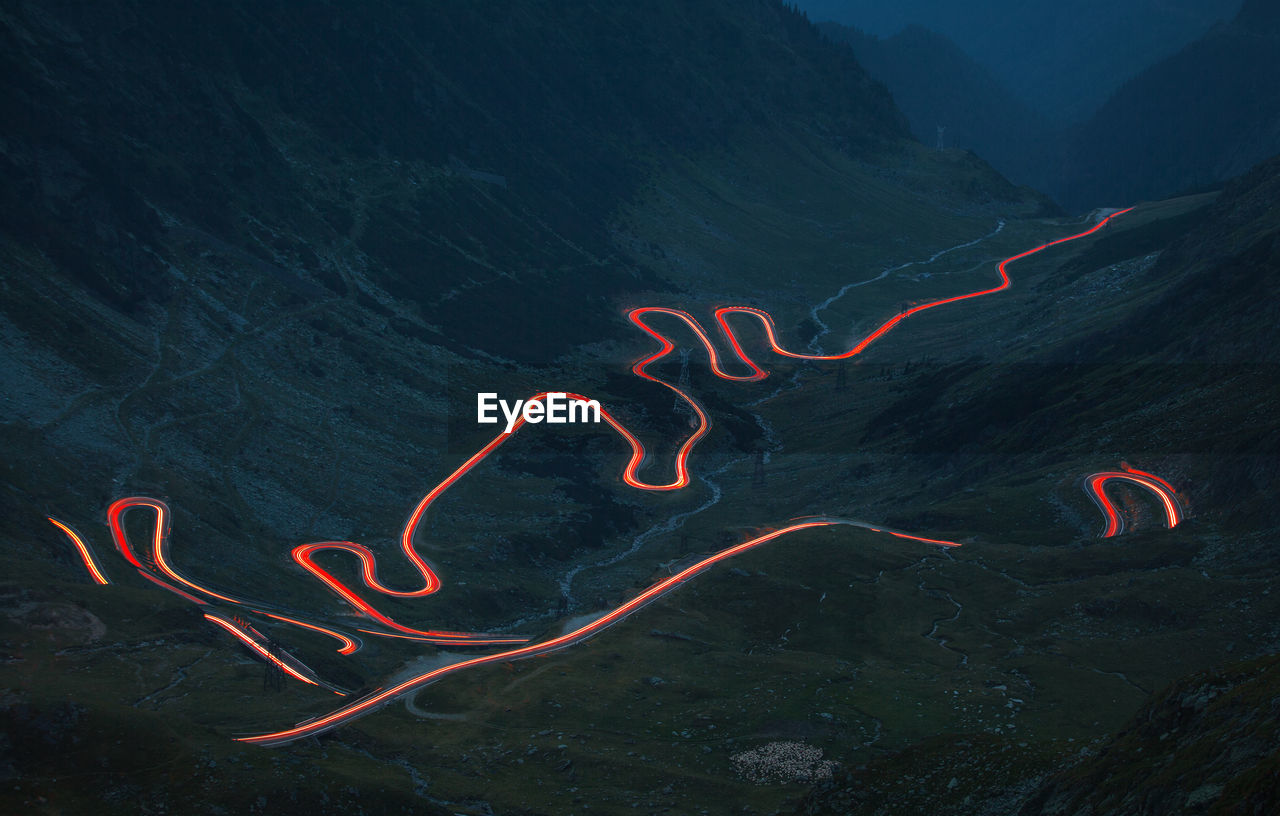 High Angle View Of Illuminated Road On Mountain At Night