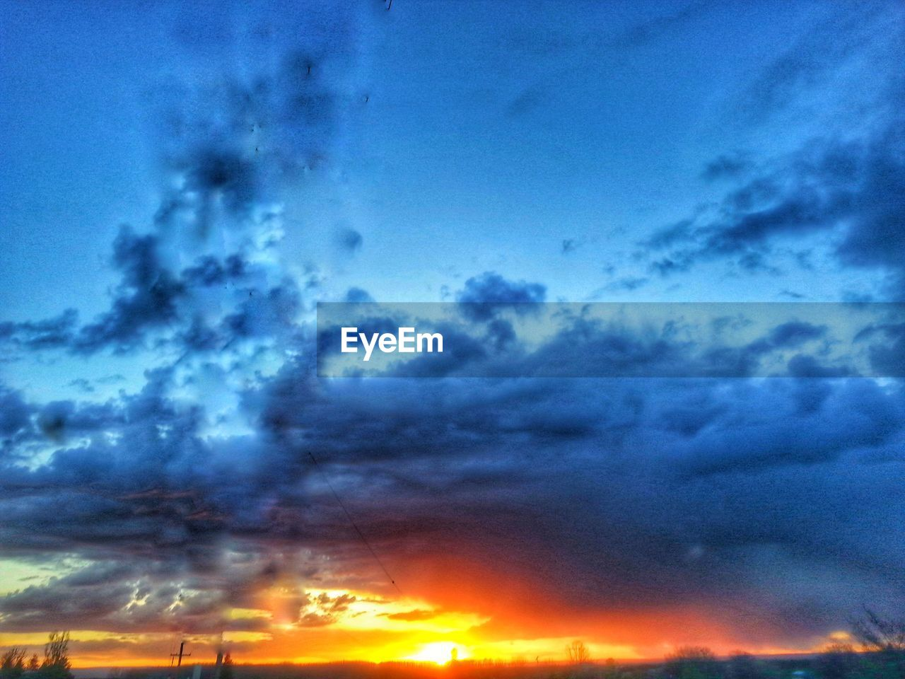 sky, nature, cloud - sky, sunset, beauty in nature, no people, dramatic sky, scenics, outdoors, tranquility, low angle view, blue, day
