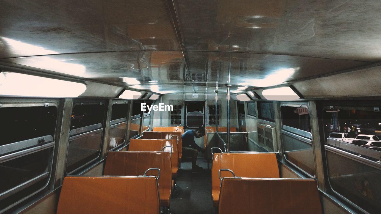 transportation, train - vehicle, indoors, mode of transport, rail transportation, subway train, public transportation, travel, journey, no people, vehicle seat, illuminated, day