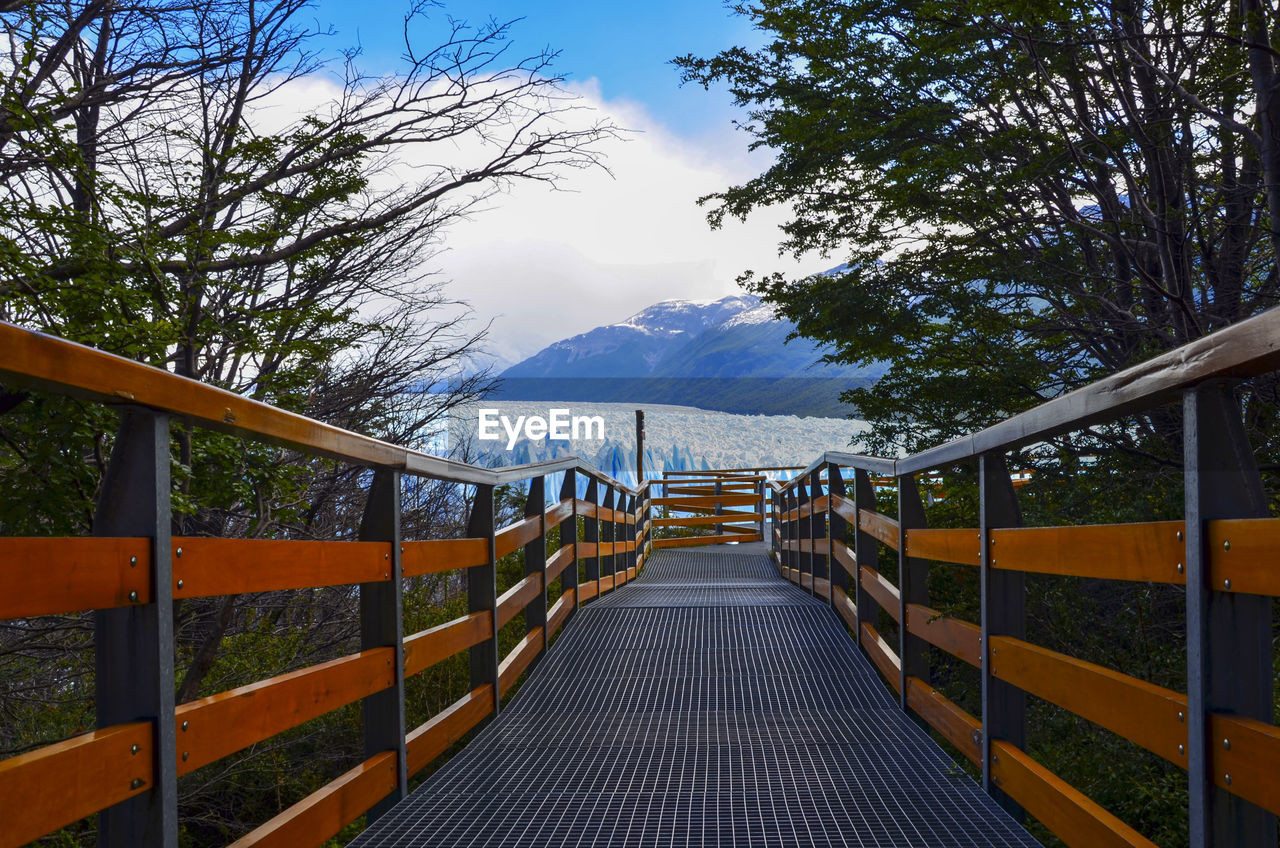 Wooden walkway with mountain in background
