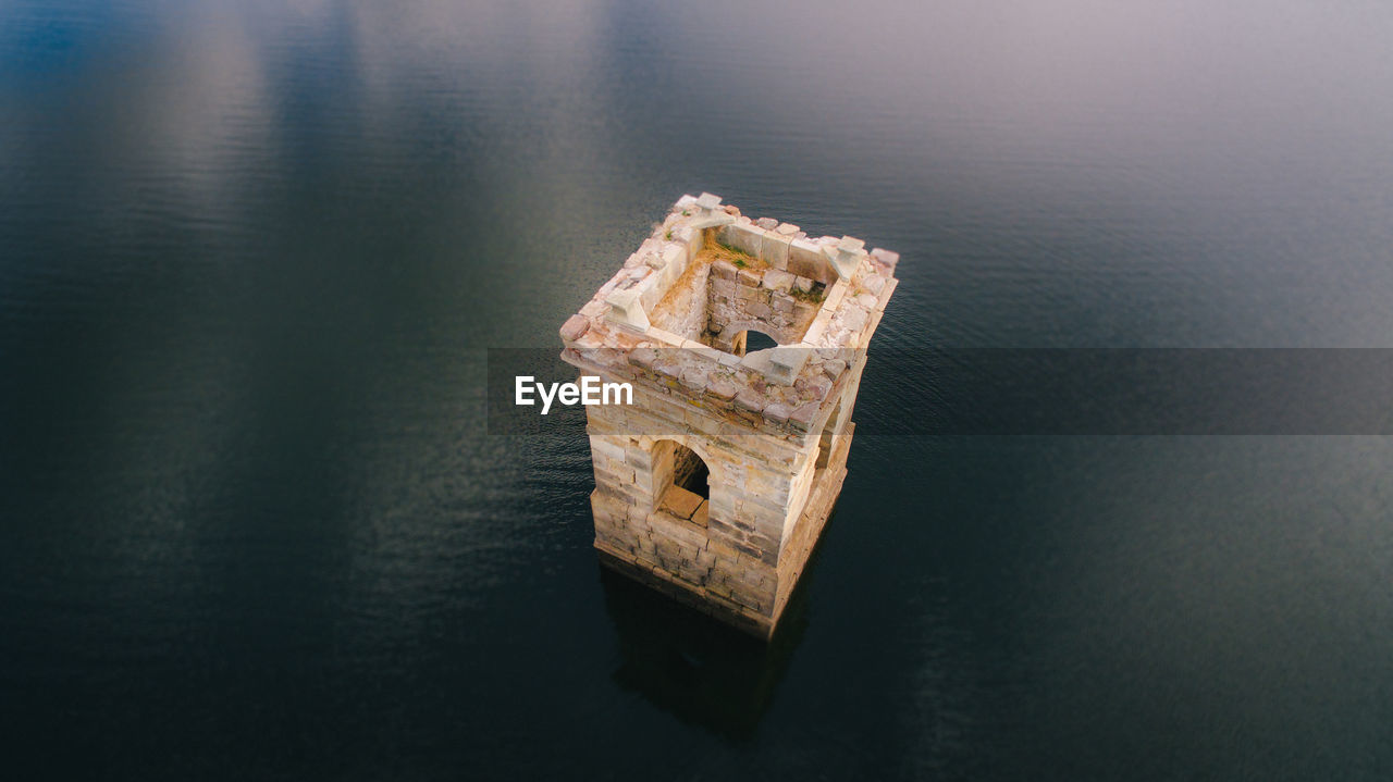 High Angle View Of Abandoned Built Structure In Sea