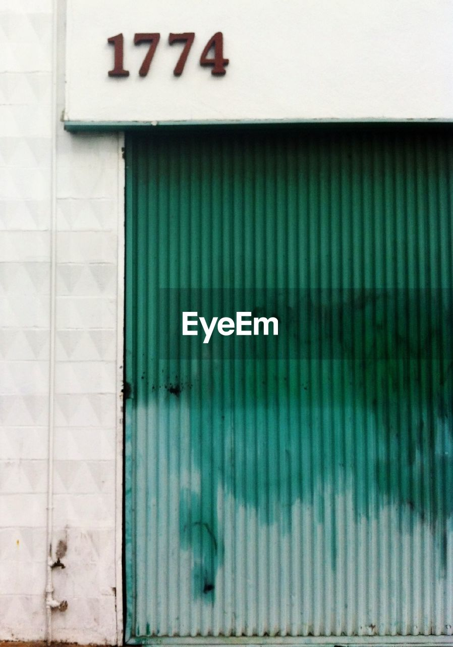 communication, metal, text, corrugated iron, built structure, day, architecture, door, outdoors, no people, building exterior, close-up