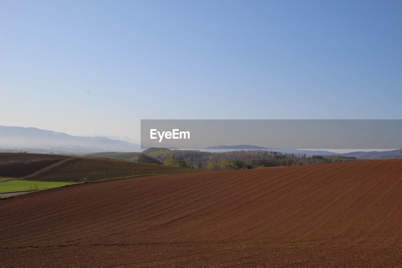 landscape, environment, sky, scenics - nature, tranquil scene, land, tranquility, beauty in nature, copy space, nature, field, mountain, clear sky, no people, day, rural scene, non-urban scene, agriculture, remote, blue, outdoors, arid climate