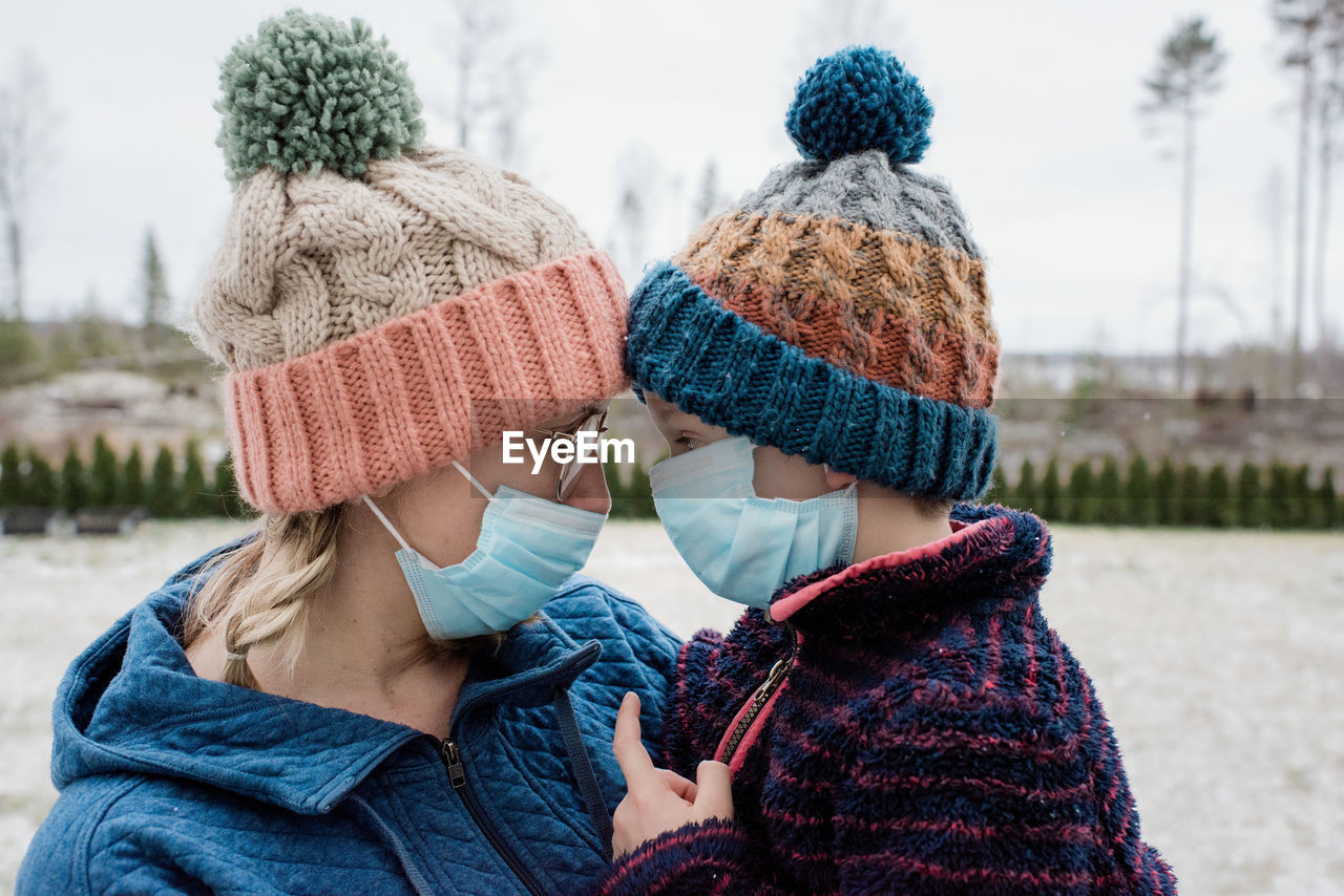 REAR VIEW OF COUPLE IN HAT
