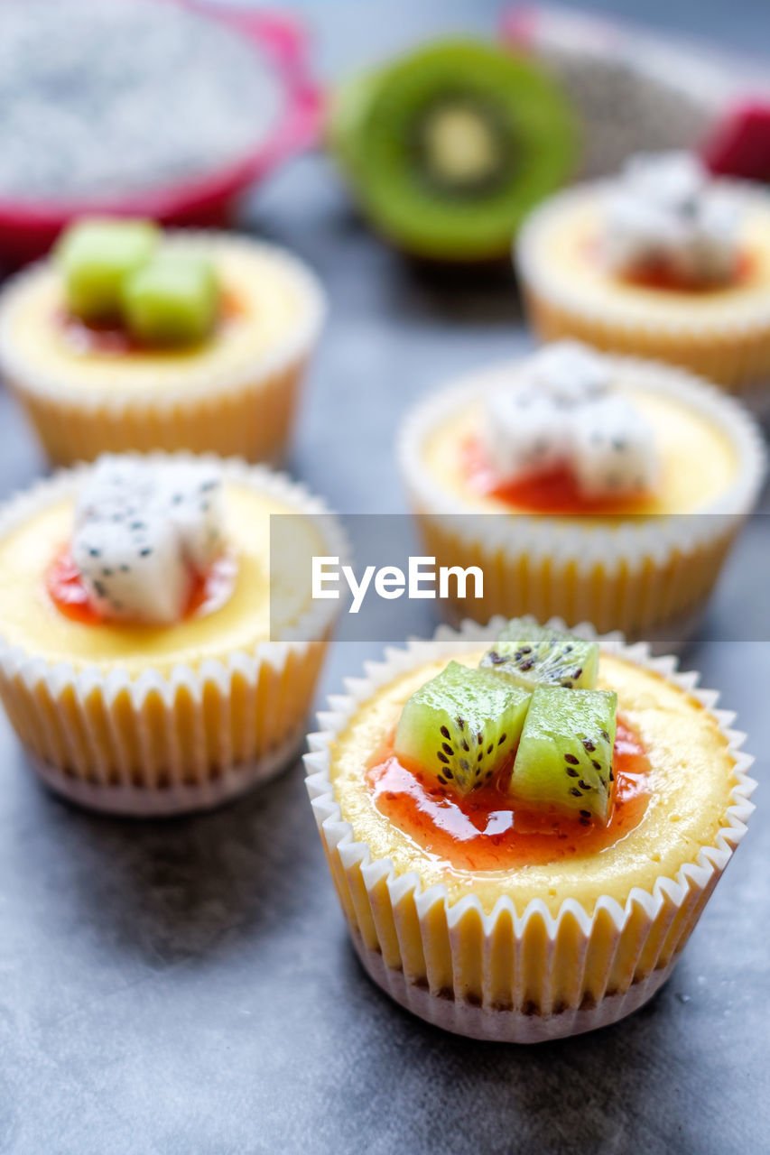 food and drink, cupcake, food, sweet, sweet food, dessert, freshness, cake, indulgence, temptation, baked, indoors, unhealthy eating, no people, ready-to-eat, close-up, focus on foreground, still life, table, selective focus, cupcake holder, baked pastry item, tart - dessert, muffin, snack