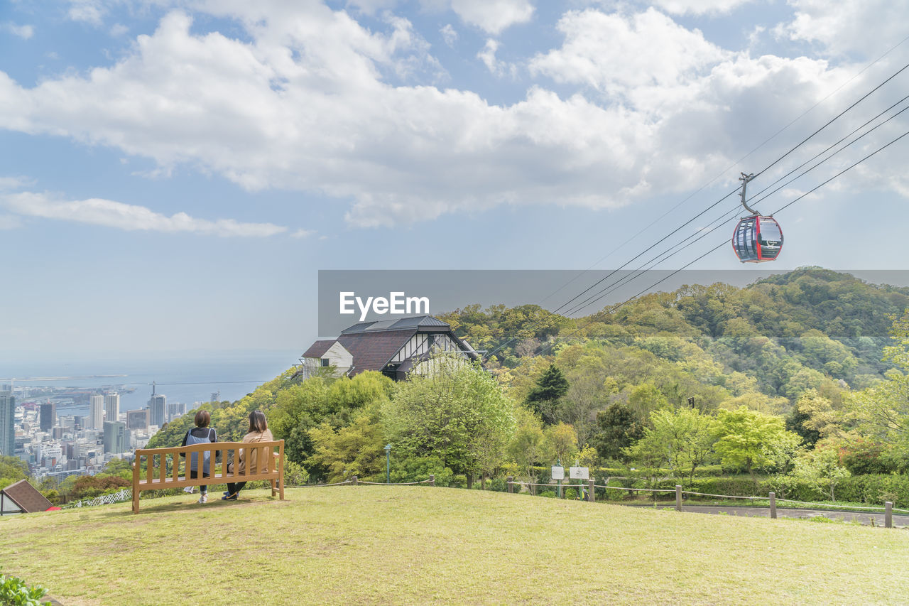 sky, cloud - sky, plant, tree, nature, architecture, day, built structure, land, building exterior, beauty in nature, cable car, green color, grass, cable, transportation, field, outdoors, environment, water
