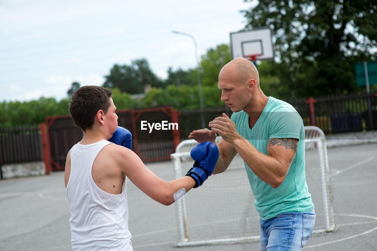Men Practicing Boxing At Court