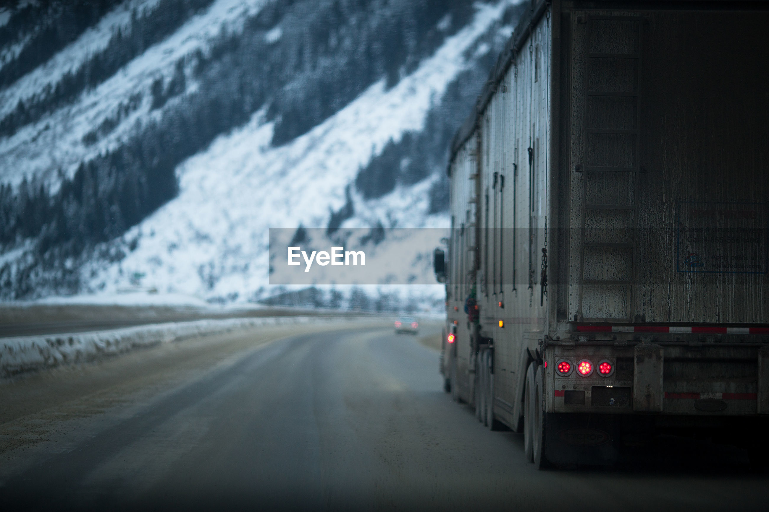 Truck moving on road during winter