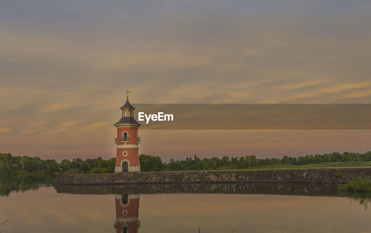 sky, sunset, built structure, water, architecture, nature, building exterior, cloud - sky, building, scenics - nature, beauty in nature, religion, no people, tower, tranquility, place of worship, belief, lake, tranquil scene, outdoors
