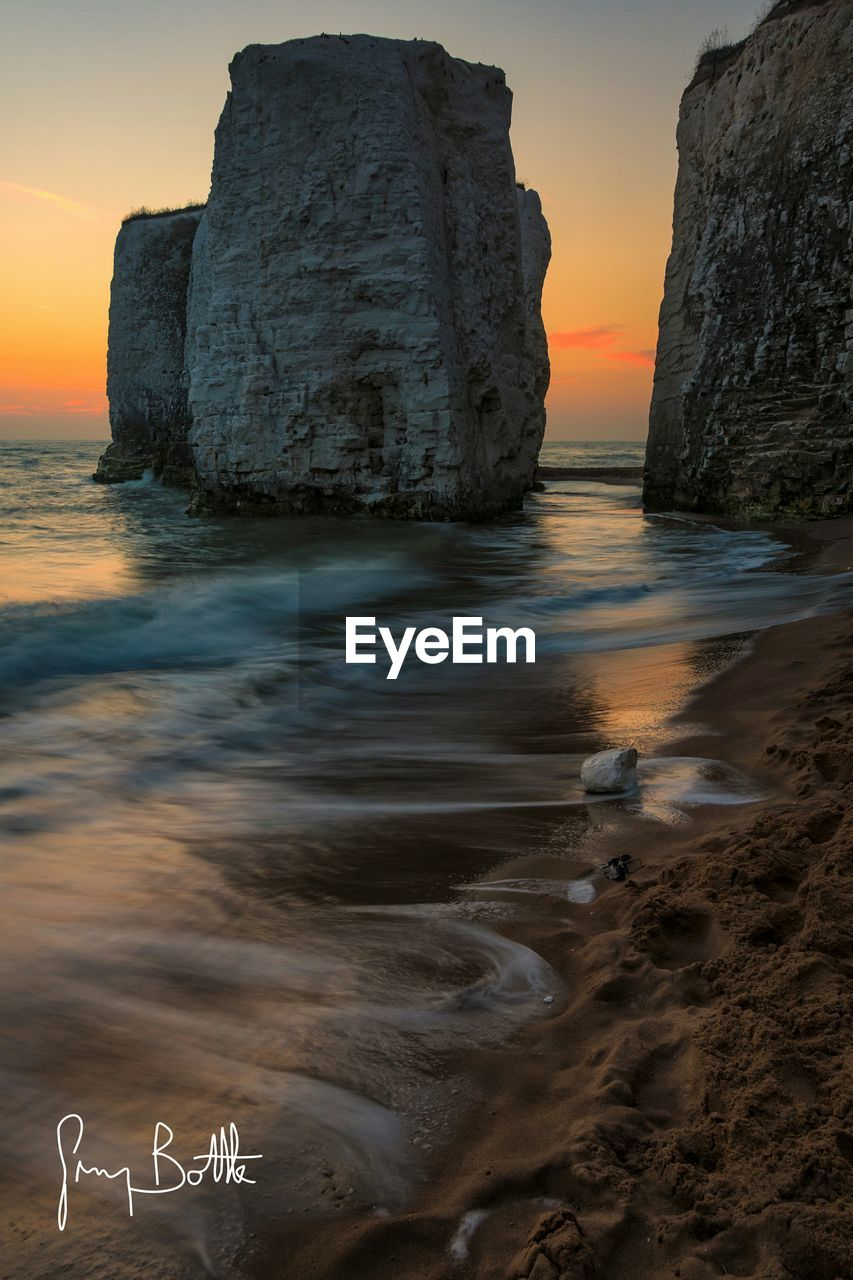 sea, water, sunset, beauty in nature, nature, rock - object, scenics, rock formation, tranquility, tranquil scene, horizon over water, beach, no people, outdoors, sky, day