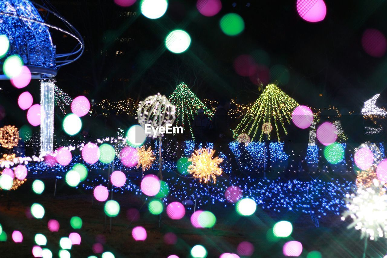 illuminated, night, christmas, christmas lights, celebration, christmas decoration, decoration, lighting equipment, christmas tree, fairy lights, christmas ornament, no people, electricity, holiday - event, bauble, outdoors, close-up, city