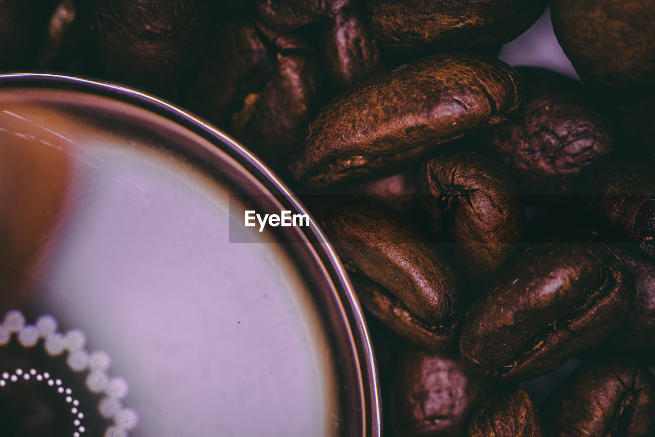 DIRECTLY ABOVE SHOT OF COFFEE BEANS IN GLASS ON TABLE