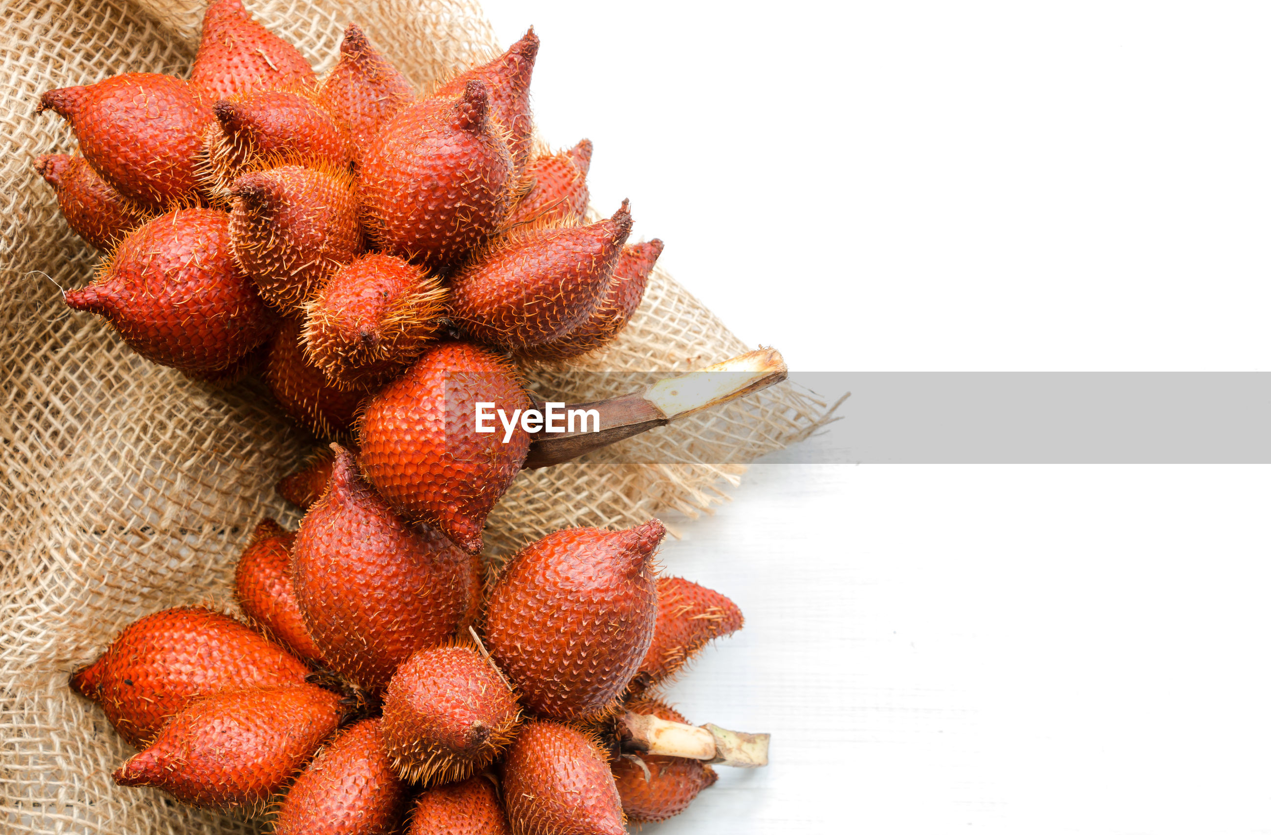 High angle view of waive fruit on white background