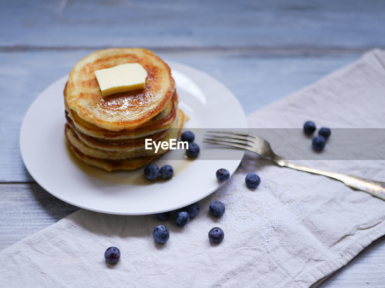 Pancakes And Blueberries On Table