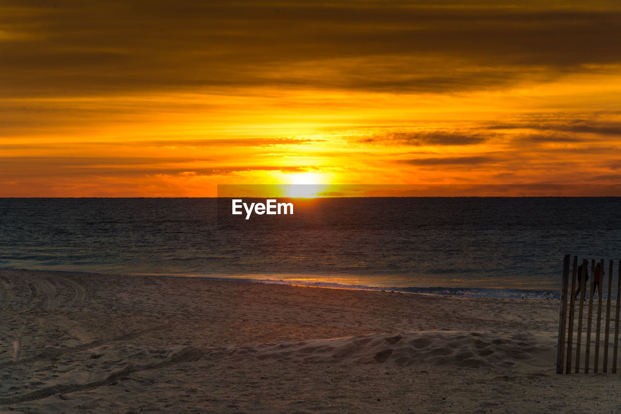 sunset, beach, sea, sand, nature, horizon over water, beauty in nature, tranquility, shore, scenics, tranquil scene, sun, sky, water, orange color, idyllic, sunlight, no people, outdoors, vacations, wave