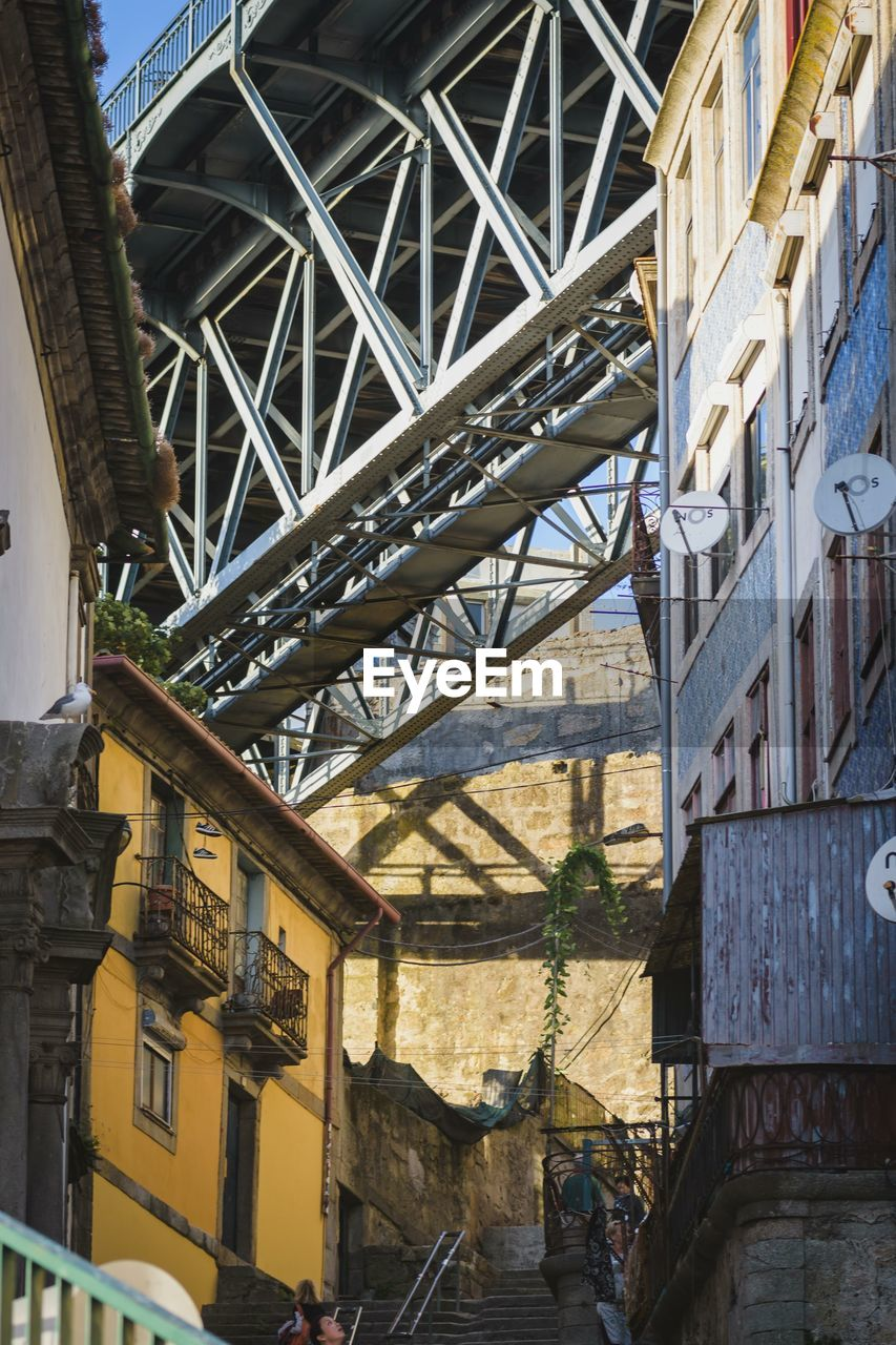 architecture, built structure, building exterior, day, building, no people, low angle view, city, outdoors, residential district, nature, metal, bridge, sunlight, old, bridge - man made structure, roof, connection, transportation, travel destinations, ceiling