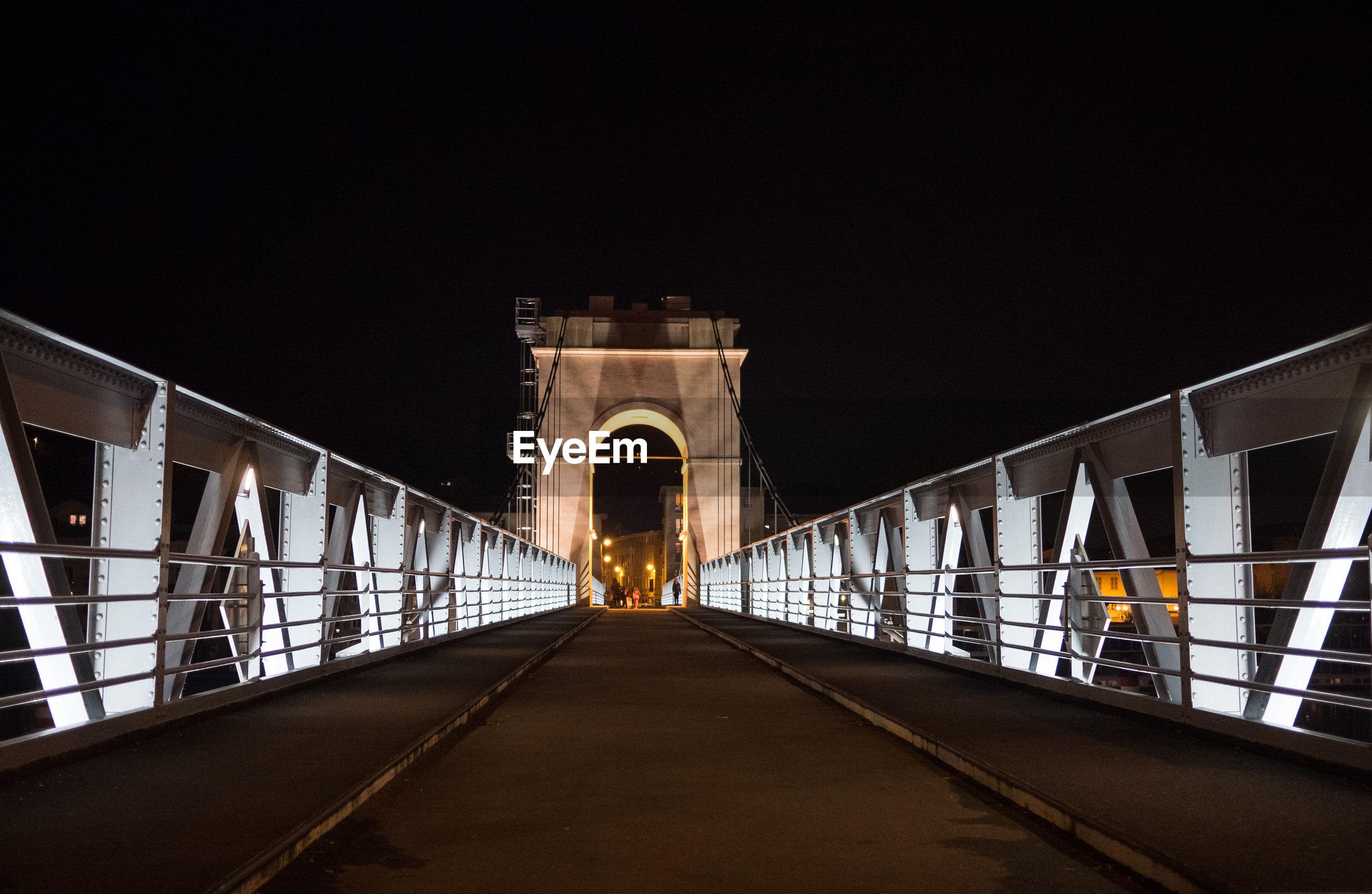 Bridge against sky at night