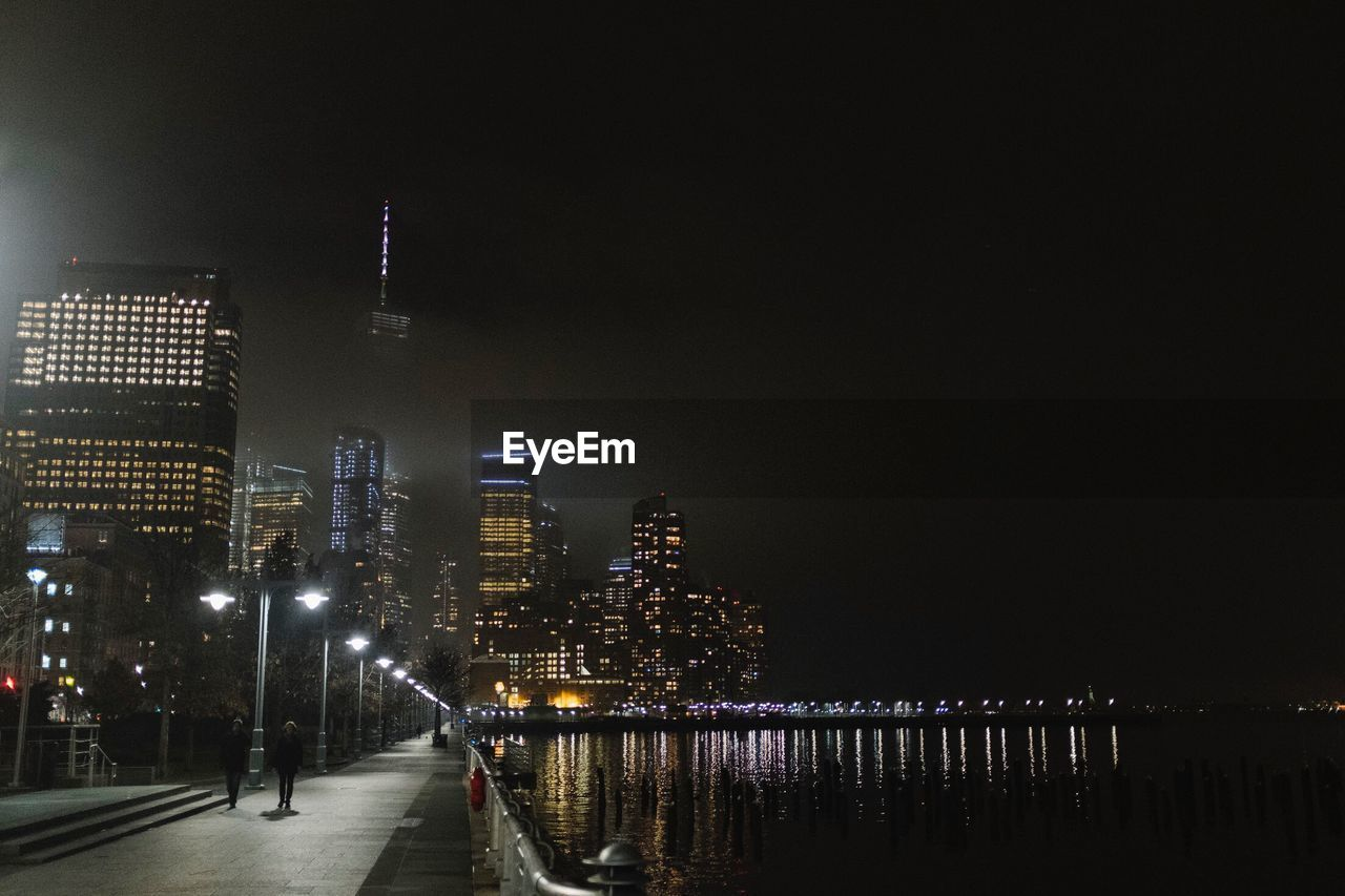 architecture, night, built structure, building exterior, illuminated, city, skyscraper, travel destinations, modern, outdoors, sky, cityscape, water, urban skyline, no people