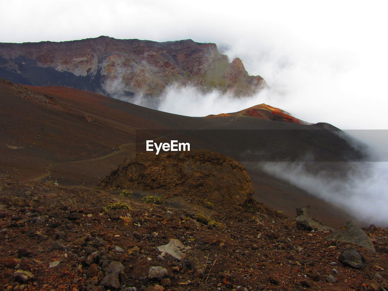mountain, beauty in nature, scenics - nature, landscape, tranquil scene, non-urban scene, tranquility, geology, environment, sky, no people, volcano, nature, rock, smoke - physical structure, physical geography, day, land, remote, mountain range, emitting, outdoors, power in nature, volcanic crater, formation