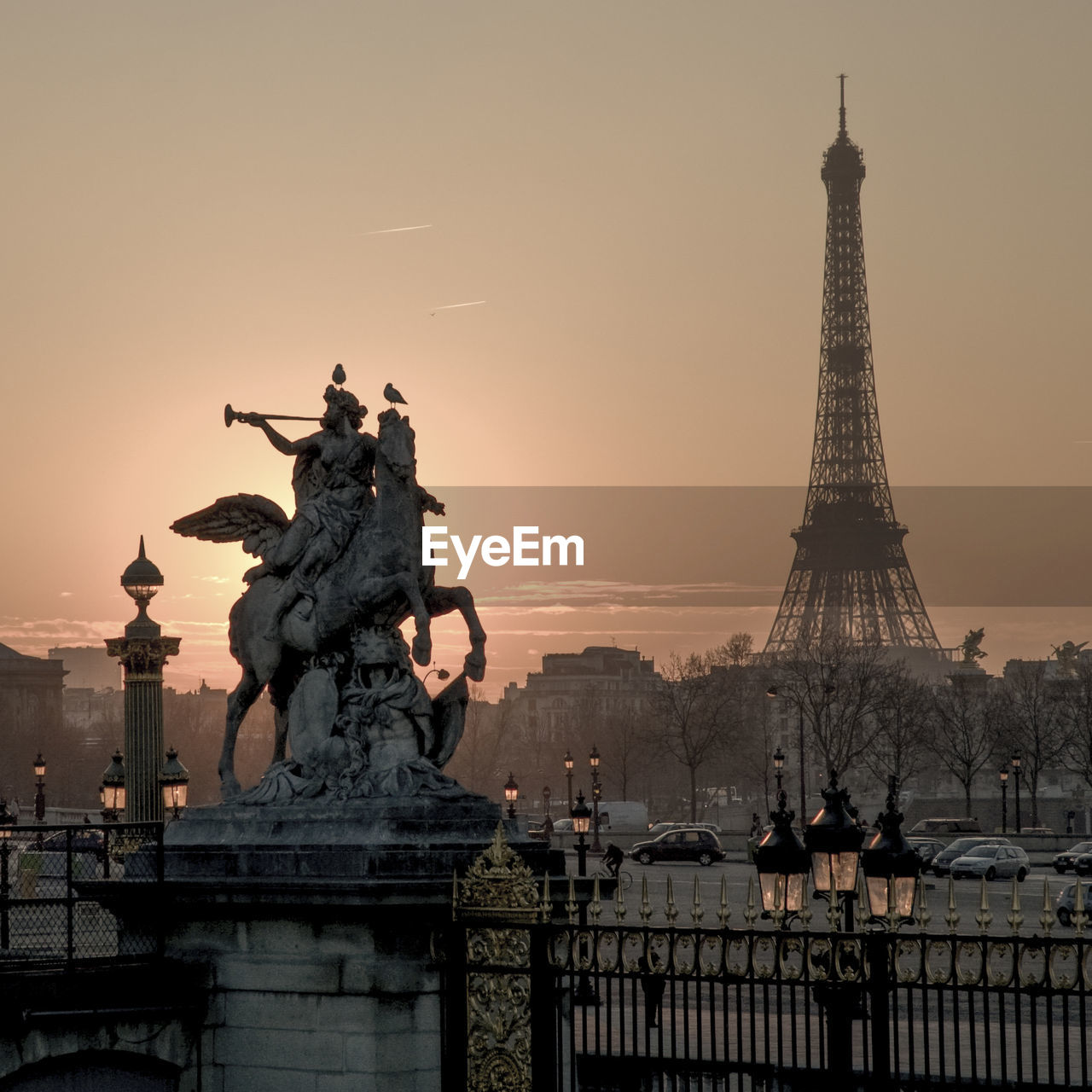 Statue At Tuileries Garden With Eiffel Tower Against Sky During Sunset