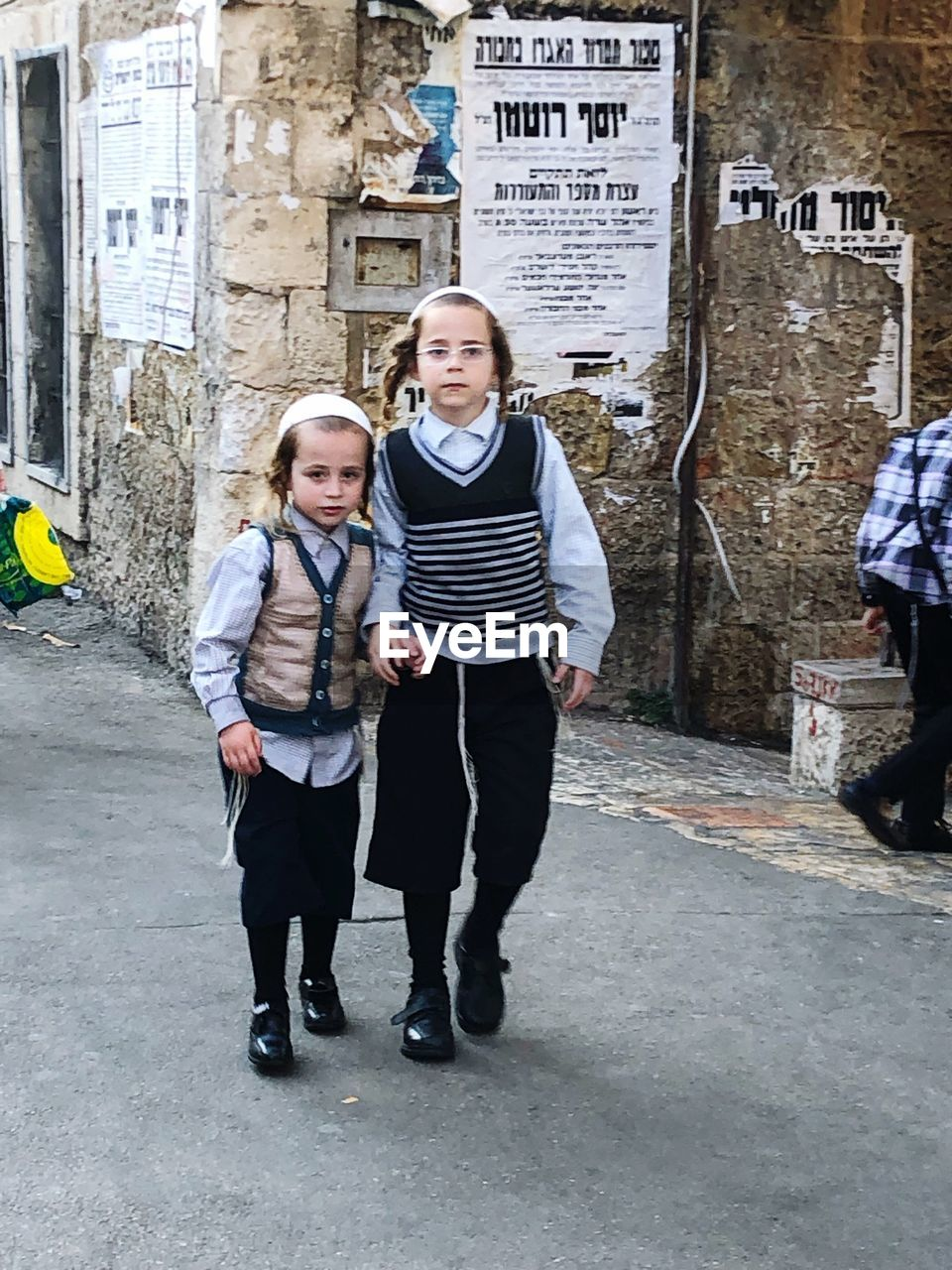 full length, casual clothing, togetherness, two people, looking at camera, portrait, women, real people, front view, men, standing, architecture, child, adult, people, males, young men, bonding, boys, teenager, adolescence, teenage boys, couple - relationship, positive emotion