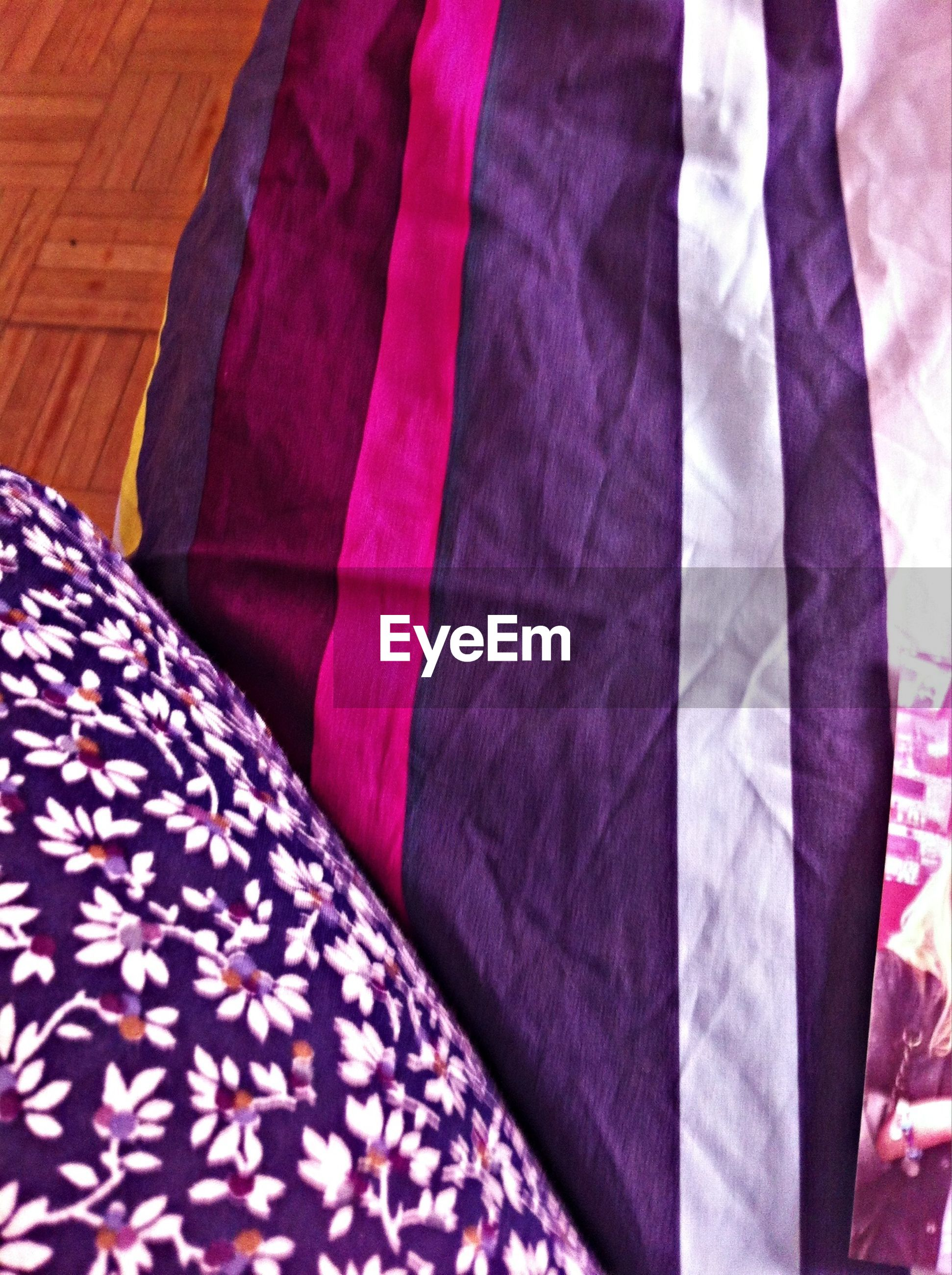 indoors, textile, fabric, pattern, full frame, bed, red, design, backgrounds, multi colored, close-up, textured, sheet, floral pattern, high angle view, pink color, material, blanket, no people, striped