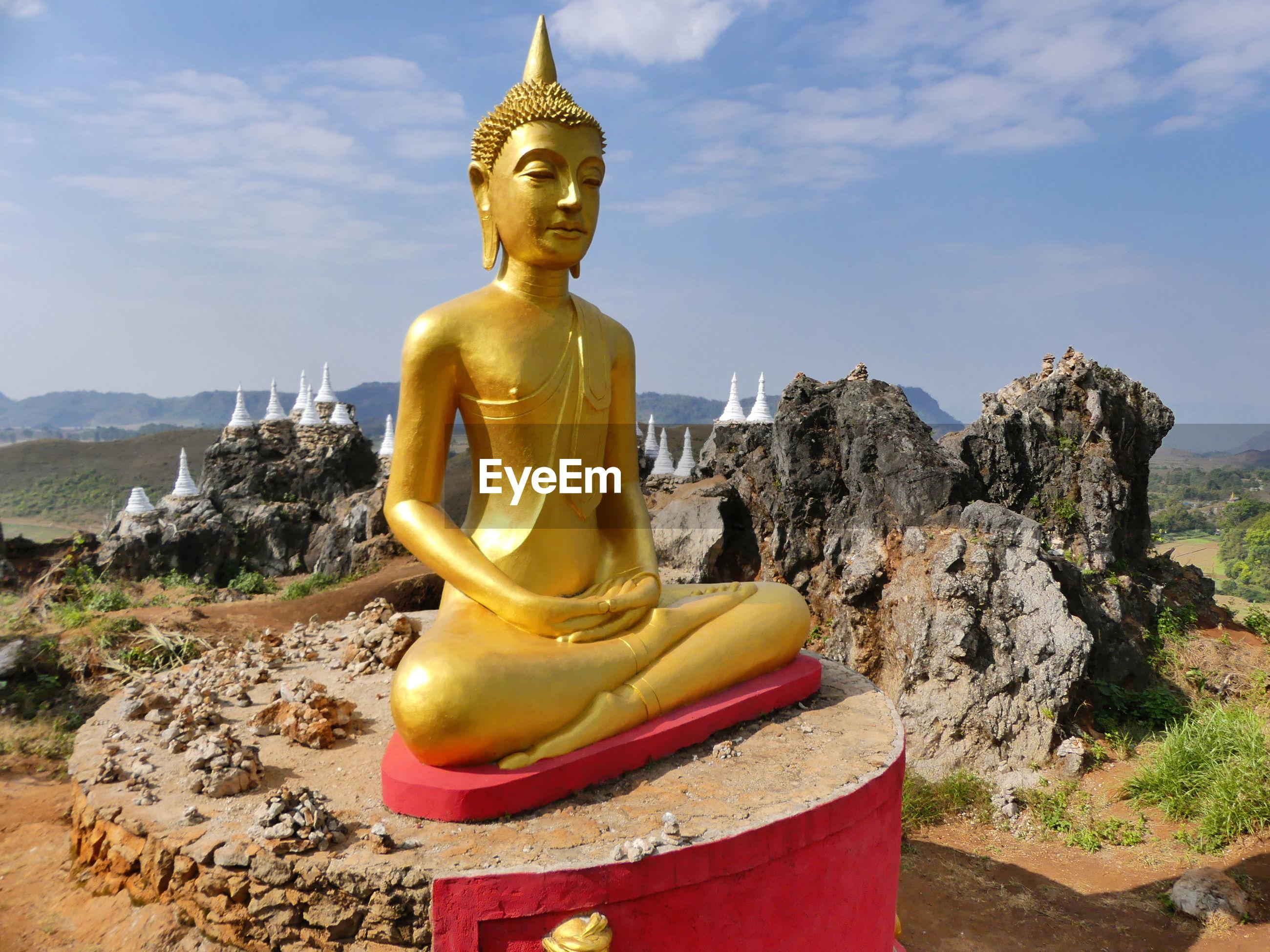 Large buddha statue against sky