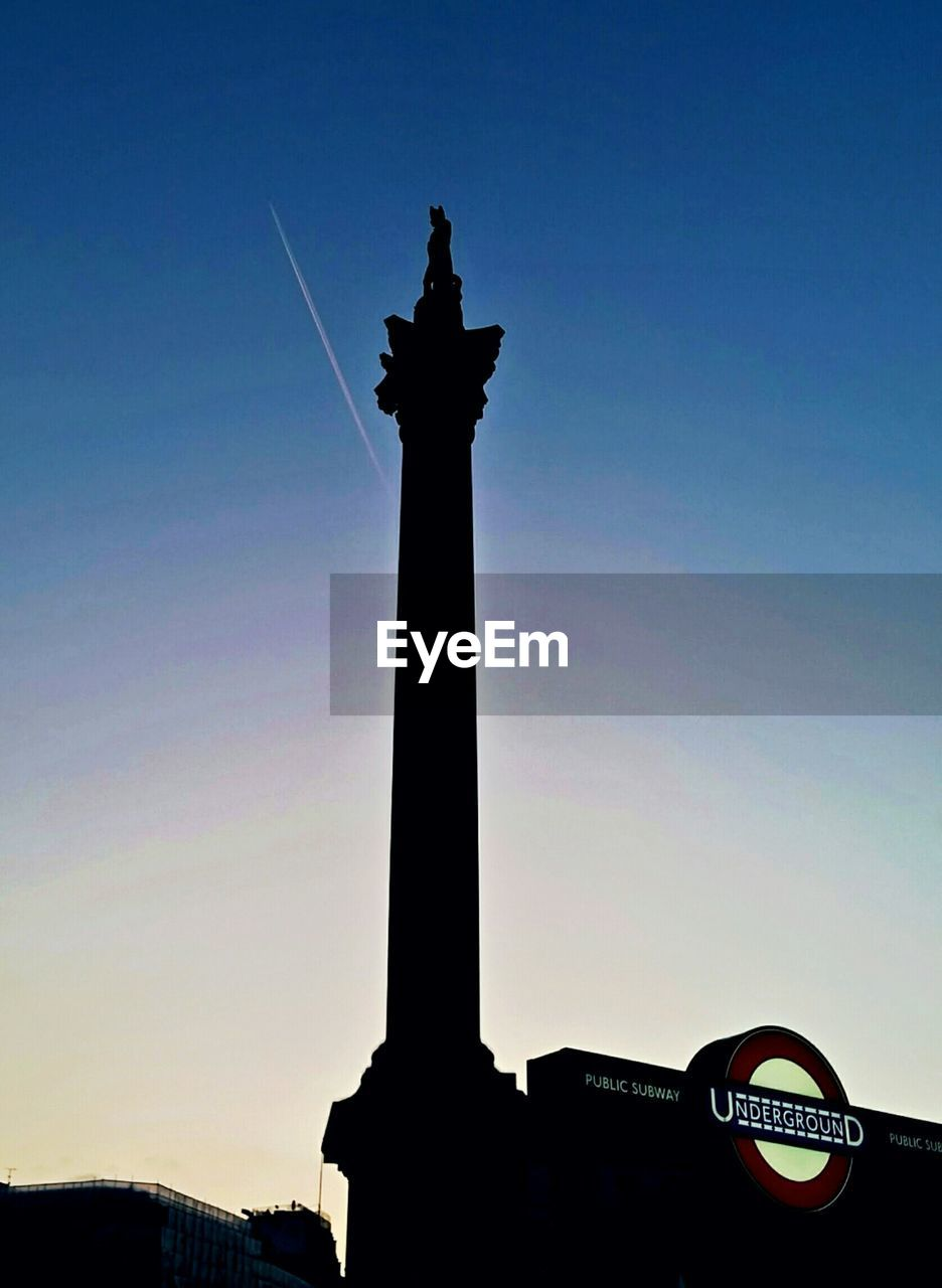 statue, architecture, built structure, low angle view, sculpture, travel destinations, human representation, sky, architectural column, outdoors, silhouette, no people, building exterior, day, clear sky, city