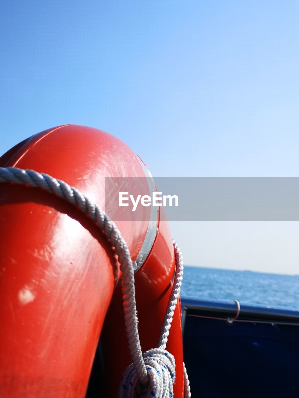 sea, water, sky, red, no people, nautical vessel, rope, clear sky, day, transportation, nature, close-up, buoy, safety, mode of transportation, blue, life belt, security, horizon over water, outdoors, inflatable