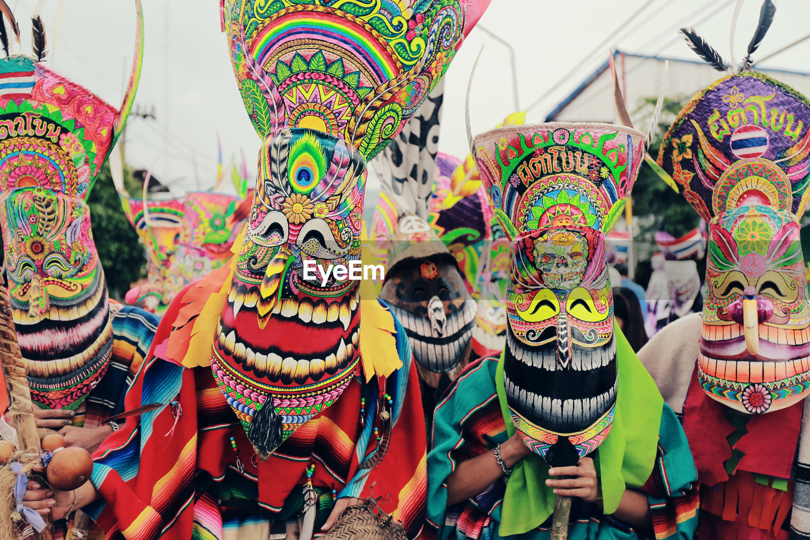 People in colorful masks during traditional festival