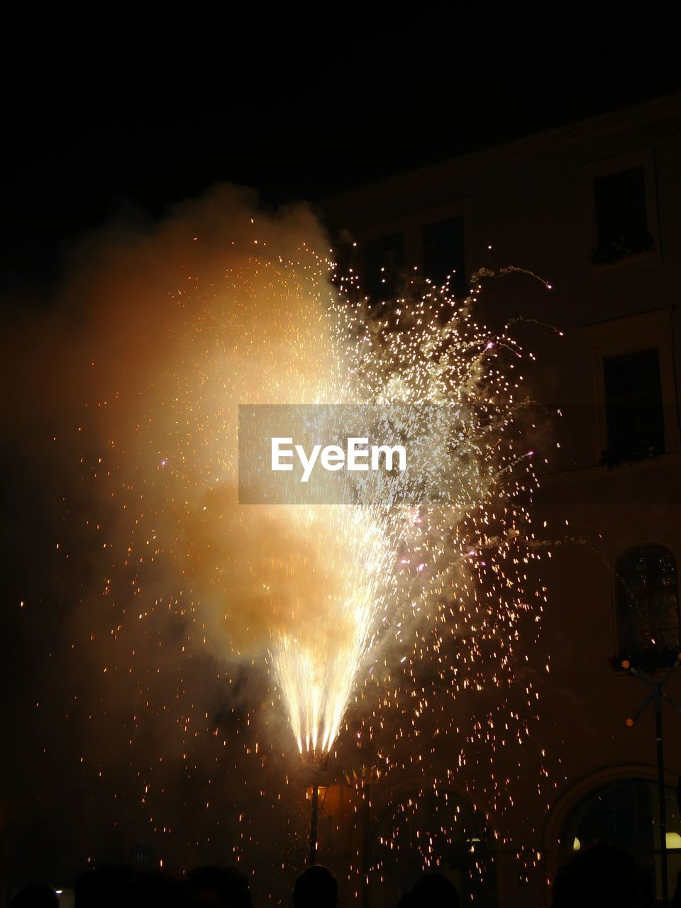night, firework display, celebration, exploding, firework - man made object, arts culture and entertainment, illuminated, event, low angle view, motion, outdoors, firework, sky, real people, architecture