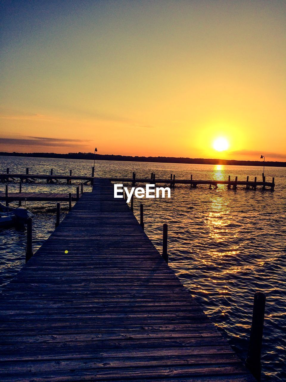 sunset, sun, pier, beauty in nature, jetty, tranquility, tranquil scene, scenics, nature, water, sea, sunlight, sky, outdoors, wood - material, clear sky, wood paneling, no people