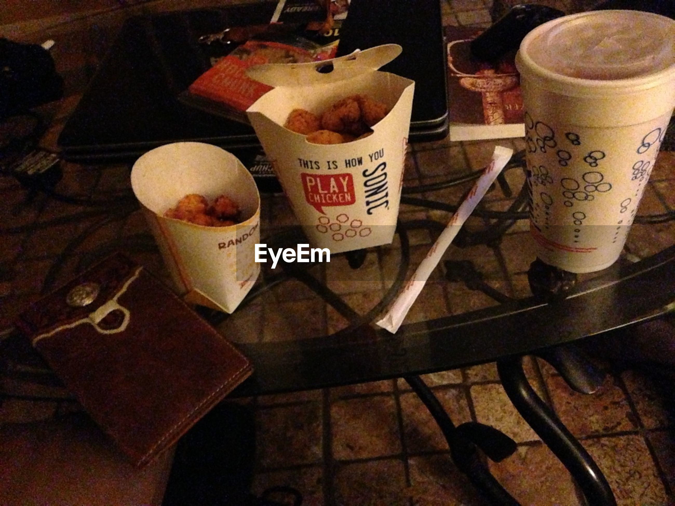 food and drink, drink, indoors, table, text, freshness, western script, still life, refreshment, communication, food, coffee cup, high angle view, coffee - drink, wood - material, no people, healthy eating, close-up, paper, restaurant