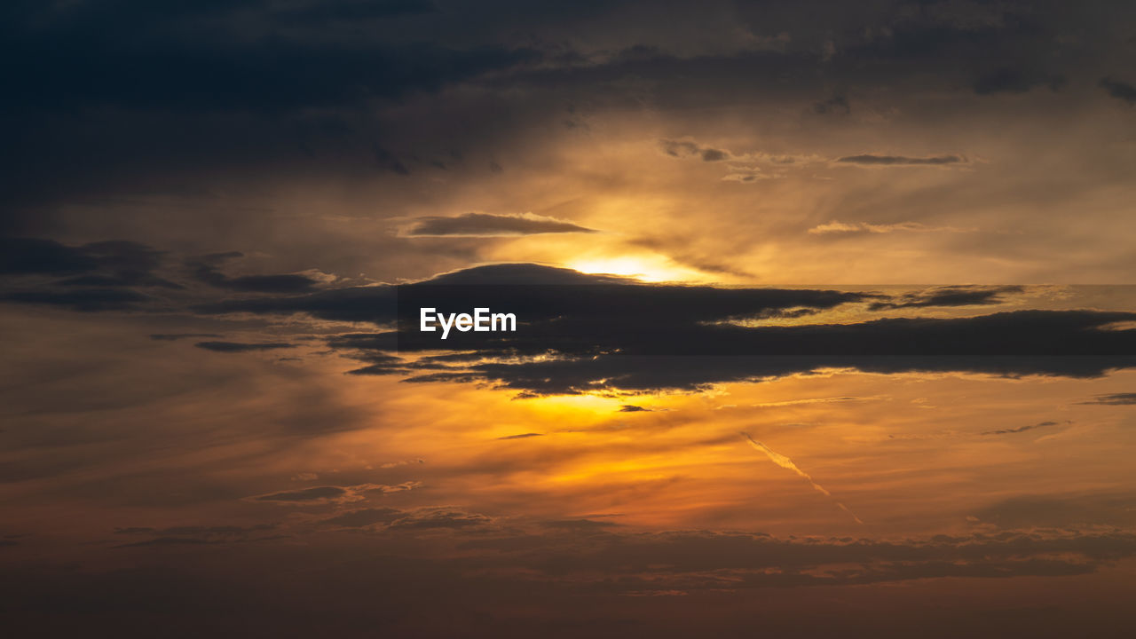 cloud - sky, sky, beauty in nature, sunset, scenics - nature, tranquility, orange color, tranquil scene, idyllic, no people, nature, dramatic sky, low angle view, outdoors, majestic, cloudscape, non-urban scene, environment, backgrounds