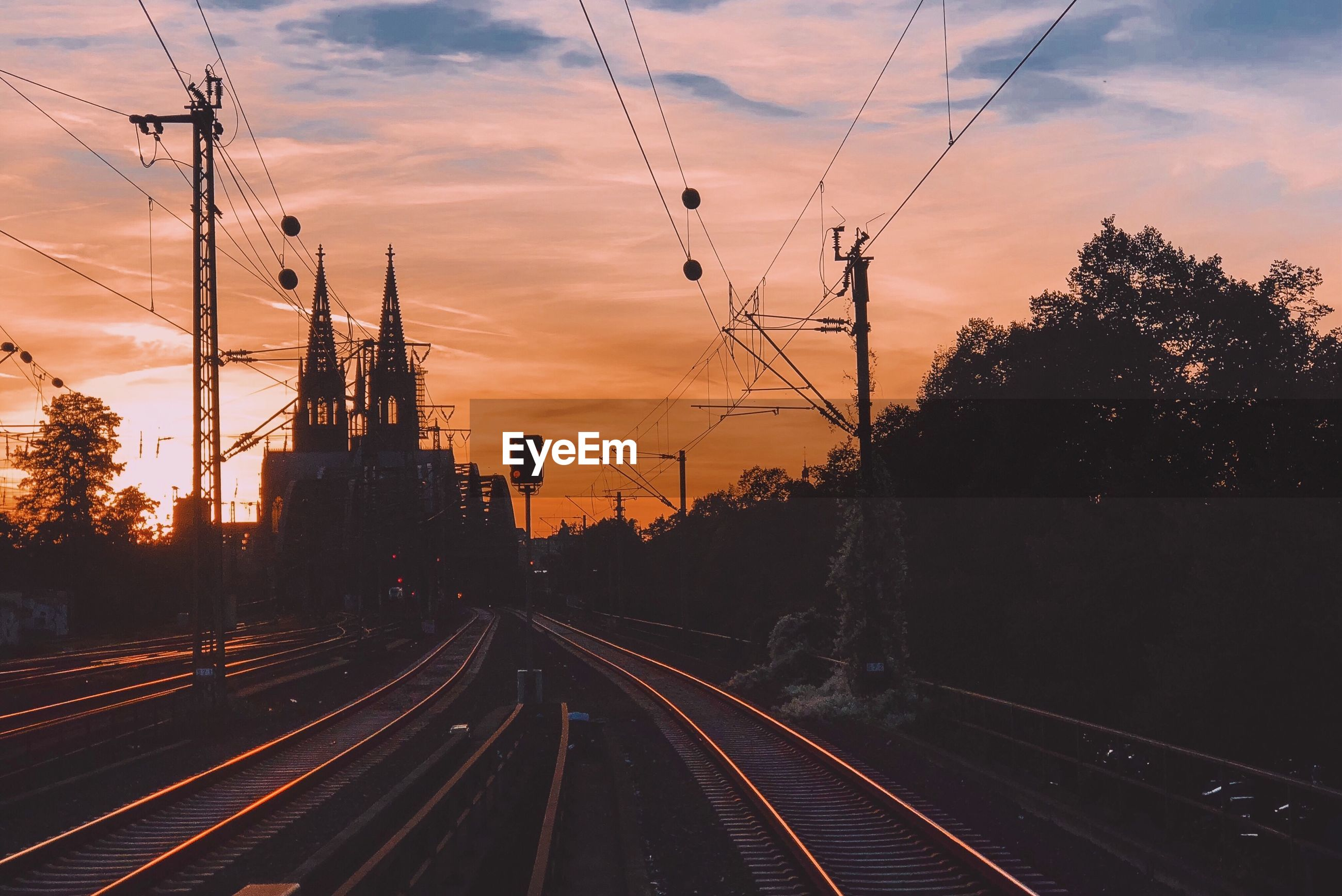 Empty railroad tracks during sunset
