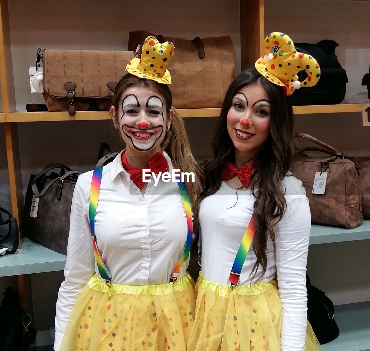 costume, leisure activity, front view, real people, two people, indoors, home interior, lifestyles, face paint, togetherness, young women, halloween, smiling, young adult, day