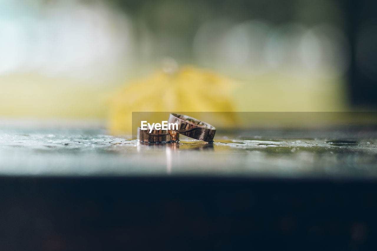 Close-Up Of Rings On Table