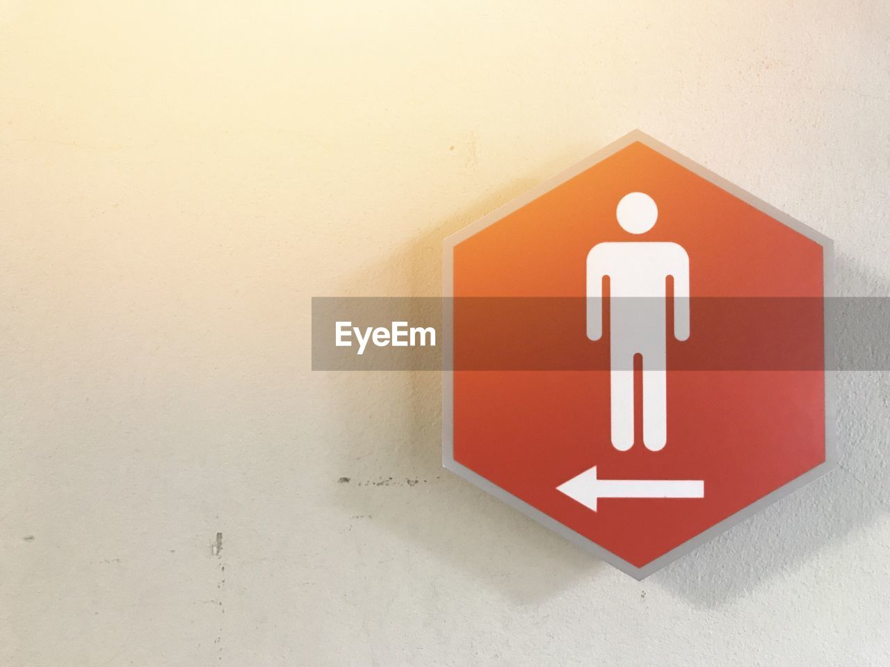 wall - building feature, communication, red, sign, indoors, no people, white color, restroom sign, public restroom, representation, human representation, information, architecture, close-up, bathroom, information sign, shape, built structure, wall, symbol, guidance