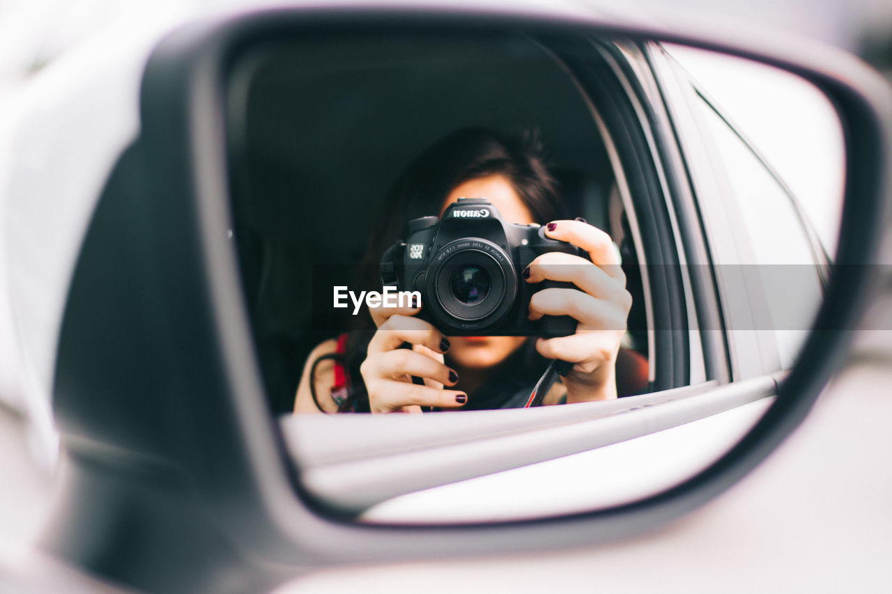 photography themes, one person, camera - photographic equipment, photographing, technology, mode of transportation, leisure activity, car, motor vehicle, headshot, reflection, land vehicle, selective focus, transportation, activity, real people, portrait, photographic equipment, lifestyles, digital camera, photographer