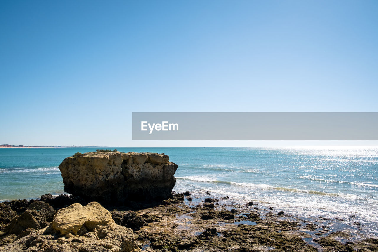 sea, water, sky, rock, beauty in nature, copy space, scenics - nature, horizon, clear sky, rock - object, horizon over water, solid, land, tranquility, tranquil scene, beach, nature, blue, day, no people, outdoors, stack rock