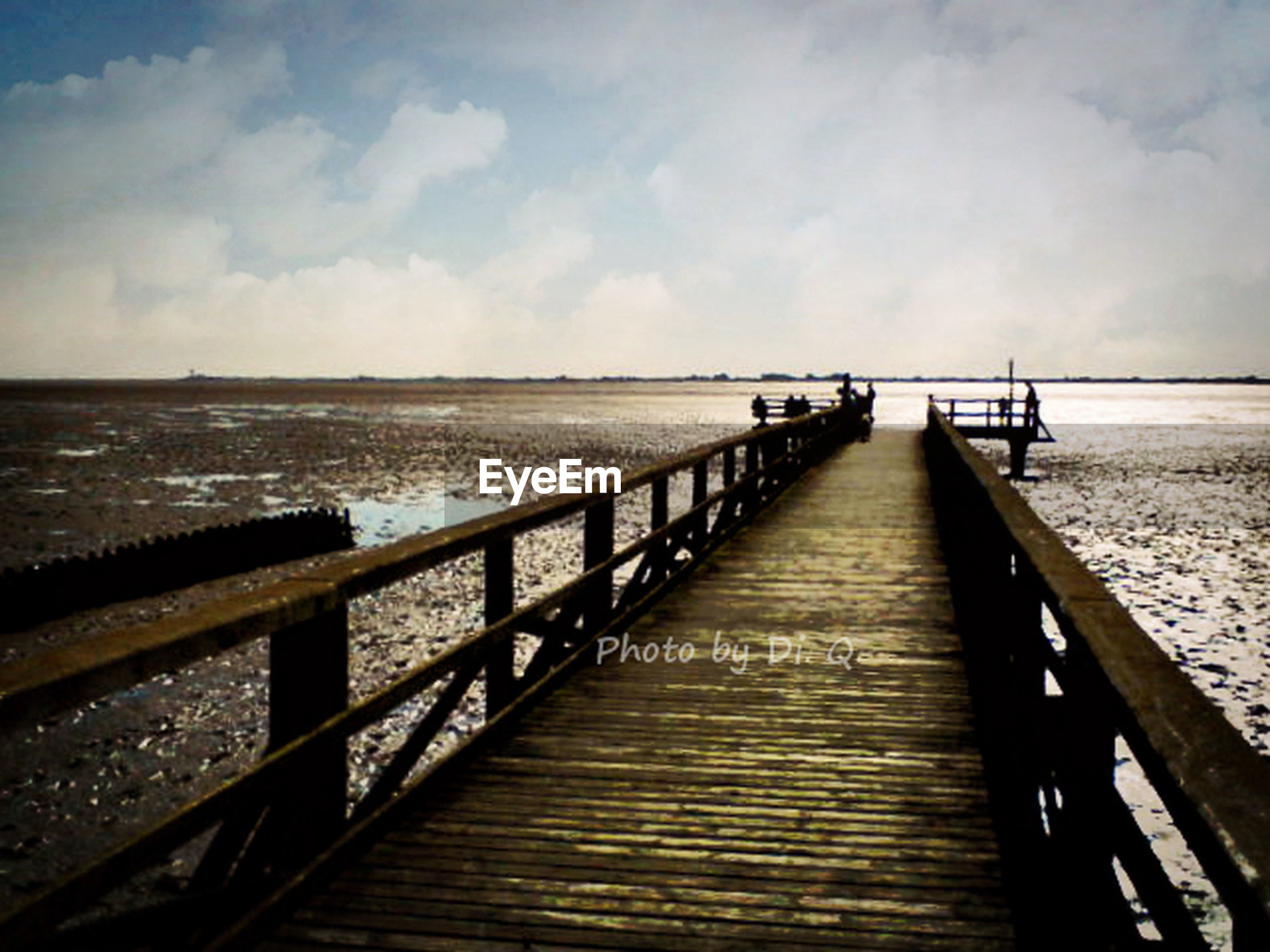sea, water, pier, horizon over water, sky, the way forward, tranquil scene, tranquility, railing, wood - material, jetty, scenics, boardwalk, beauty in nature, nature, wood, idyllic, cloud - sky, long, diminishing perspective