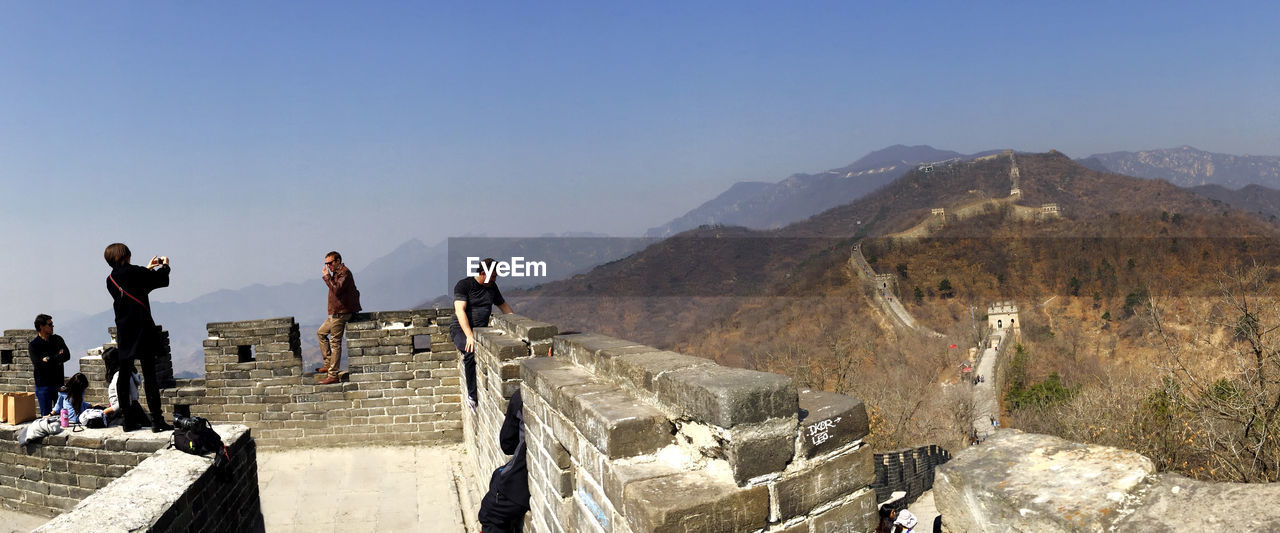 People at great wall of china against sky